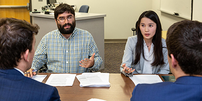 Law students argue during the Jaffe Transactional Law Competition