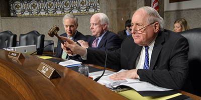 Sen. Levin seated next to Sen. McCain at a hearing